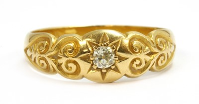 Lot 24-An 18ct gold diamond ring