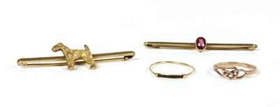 Lot 25 - A gold dog bar brooch