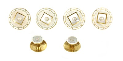 Lot 171 - A cased matched set of two dress studs and four gold mother-of-pearl, pearl and enamel buttons