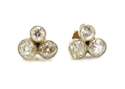 Lot 22 - A pair of trefoil diamond cluster stud earrings