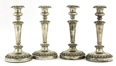 Lot 27 - A set of four William IV silver candlesticks
