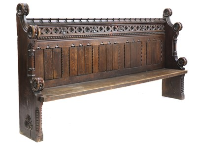 Lot 43 - A carved pew or settle