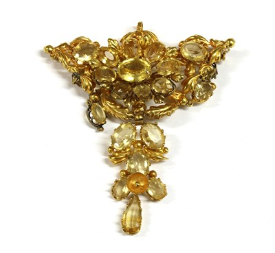 Lot 7-An early Victorian gold mounted citrine brooch/pendant, c.1840