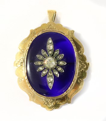 Lot 11-A gold glass and diamond pendant/brooch