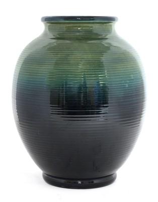 Lot 219 - A William Moorcroft ribbed ovoid vase