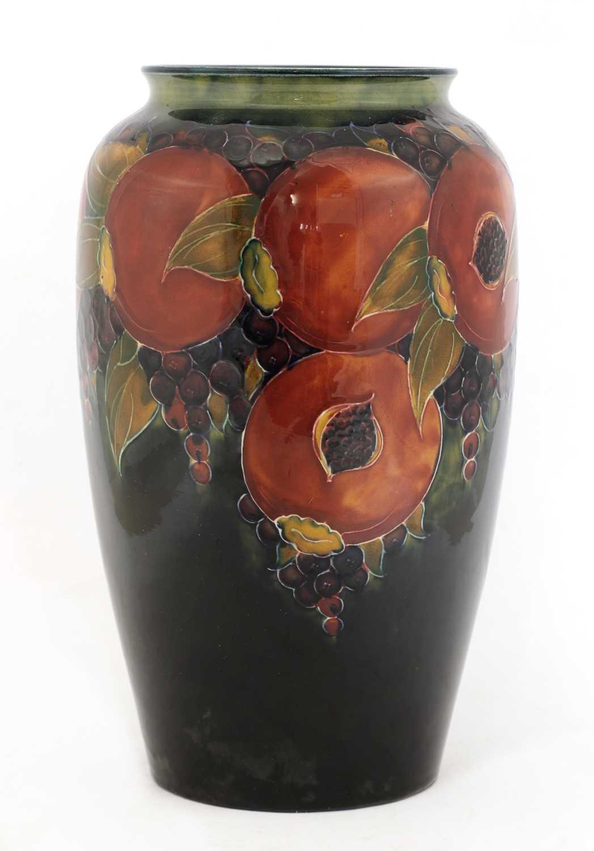 Lot 220 - A William Moorcroft tubeline decorated 'Pomegranate' vase