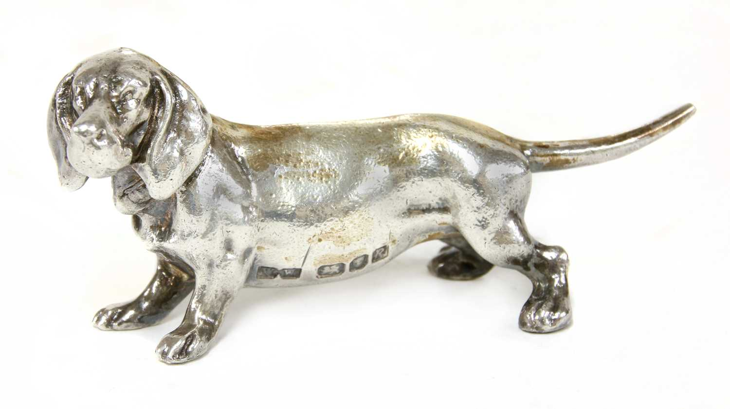 Lot 15-A cast silver figure of a dachshund
