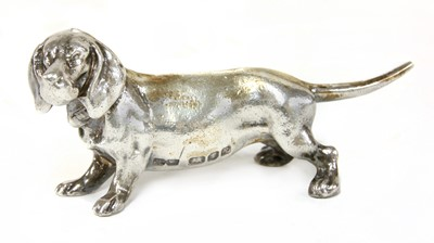 Lot 15 - A cast silver figure of a dachshund
