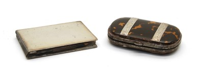 Lot 9-A 19th century silver and tortoiseshell purse of ovoid shape