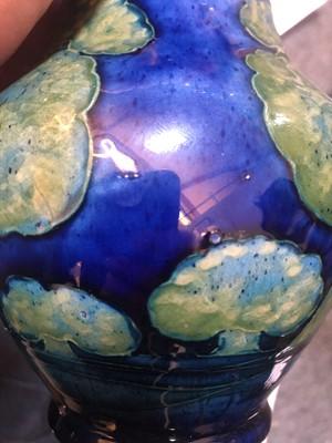 Lot 213 - A Moorcroft 'Moonlit Blue' baluster vase