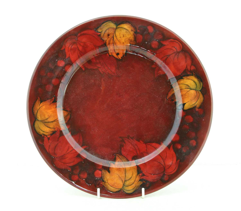 Lot 211 - A Moorcroft flambé 'Leaf and Berry' dish