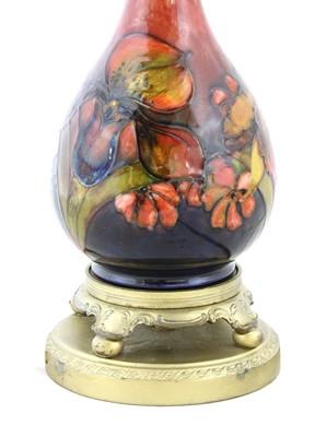 Lot 212 - A Moorcroft flambé 'Orchid' table lamp