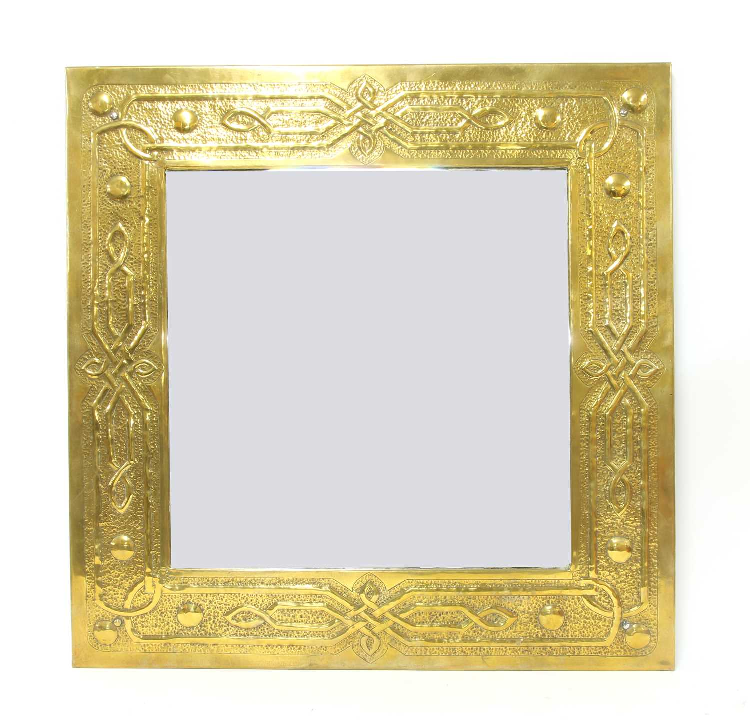 Lot 37 - An Arts and Crafts embossed brass mirror