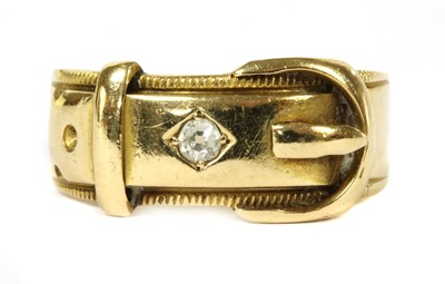 Lot 25-An 18ct gold diamond set buckle ring