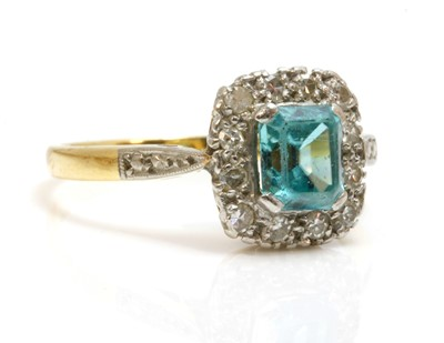 Lot 145 - A blue zircon and diamond rectangular cluster ring