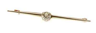 Lot 151 - A single stone diamond set bar brooch