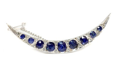 Lot 46 - An Edwardian sapphire and diamond crescent brooch, c.1910