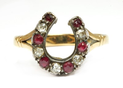 Lot 33-A gold and silver, diamond and ruby, horseshoe ring