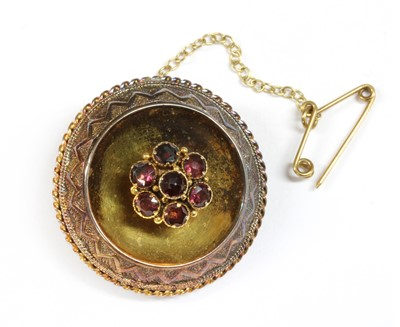 Lot 7-A Victorian gold garnet brooch