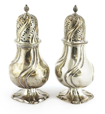 Lot 33 - A pair of Dutch silver casters