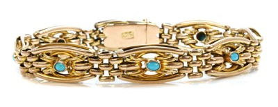 Lot 90 - An Edwardian gold and turquoise set gate bracelet