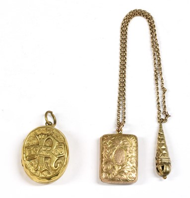 Lot 11-A gilt metal oval 'Regard' locket