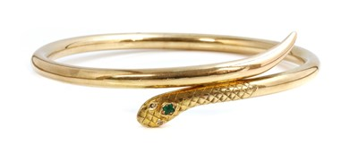 Lot 72 - An early 20th century gold emerald and diamond set serpent or snake bangle