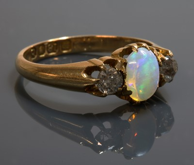 Lot 107 - An 18ct gold late Victorian three stone opal and diamond ring
