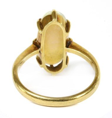 Lot 19-An Edwardian gold single stone opal ring