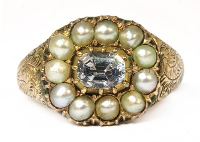 Lot 28-A white sapphire and split pearl cluster ring