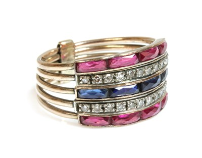 Lot 156 - An Art Deco-style five row synthetic sapphire, synthetic ruby and diamond harem ring, c.1950