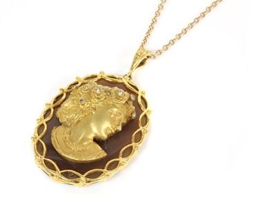 Lot 185 - A 9ct gold diamond set profile or cameo habillé-style agate pendant, c.1970