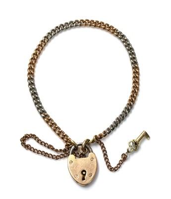 Lot 158 - A two colour gold and platinum curb link bracelet, c.1920