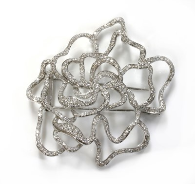 Lot 90 - A Continental white gold diamond set ghost rose brooch