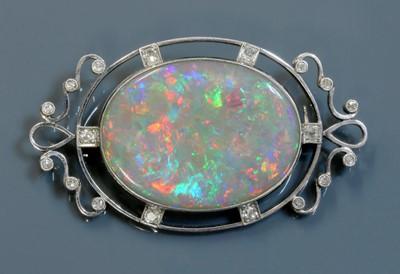 Lot 110 - An Edwardian white gold opal and diamond brooch