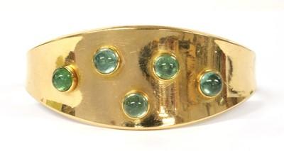 Lot 19 - A gold gem-set torque bangle