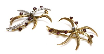 Lot 179 - A pair of 9ct two colour gold, diamond and ruby star/flower brooches, c.1970