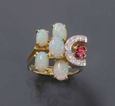 Lot 197 - A Continental opal, ruby and diamond asymmetrical cluster ring, c.1970