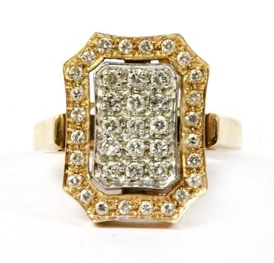 Lot 54 - A two colour gold pavé diamond ring