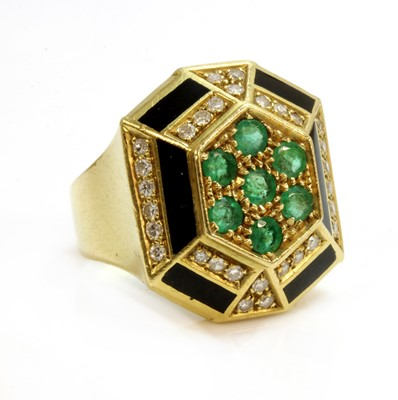 Lot 198 - An Italian emerald, diamond and black enamel ring, with an octagonal domed head, c.1960