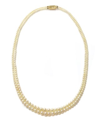 Lot 122 - A cased two row graduated natural pearl necklace