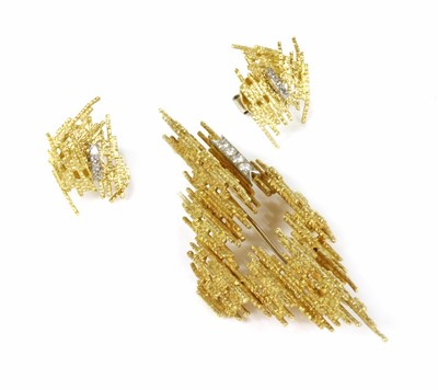 Lot 195 - An 18ct gold diamond set brooch and earring suite by Andrew Grima, c.1970