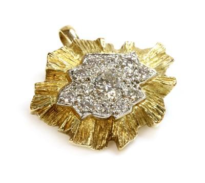 Lot 196 - A yellow and white gold diamond set brooch pendant