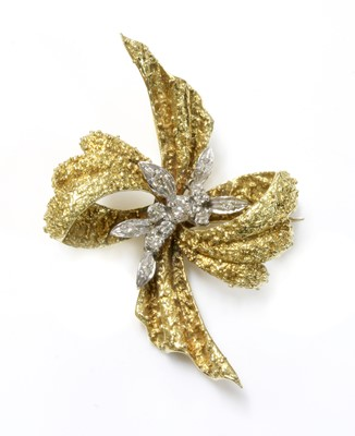 Lot 161 - An 18ct yellow and white gold diamond set bow brooch, c.1970