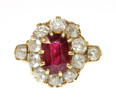Lot 41 - A late Victorian ruby and diamond oval cluster ring