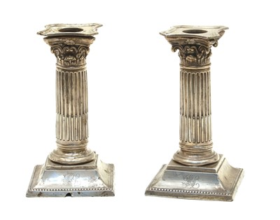 Lot 15-A pair of silver candlesticks
