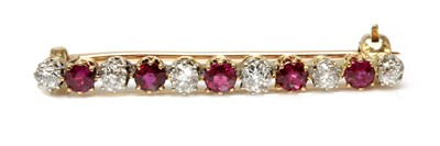 Lot 36 - A ruby and diamond two colour bar brooch