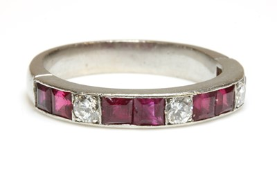 Lot 154 - A diamond and ruby half eternity ring