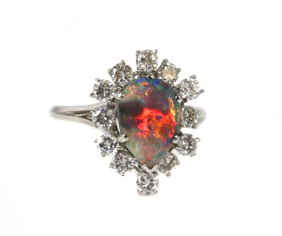 Lot 103 - A black opal and diamond pear-shaped cluster ring