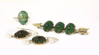 Lot 10-A silver gilt scarab beetle set arrow brooch